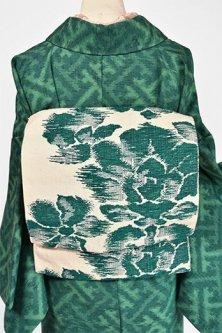 アイボリーにディープグリーンの西洋フラワー美しい紬つくり帯