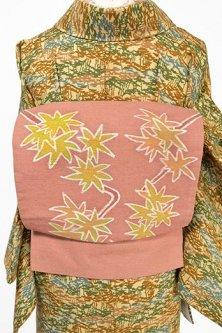 蘇芳香色地にろうけつ染調の青葉紅葉美しい正絹紬つくり帯