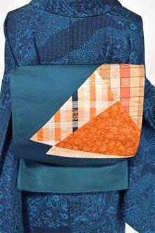 濃藍色地に名物裂調切り嵌め文様小粋な洒落袋帯