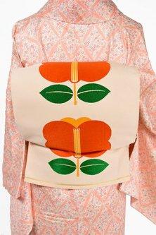 アイボリーにブルーナの絵本のような遠州椿愛らしい洒落袋帯