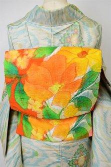 ソレイユオレンジに西洋の花庭美しい正絹紬名古屋帯