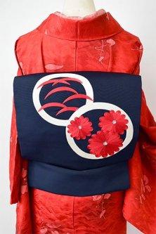濃紺色地に丸に草花の刺繍文様美しい名古屋帯