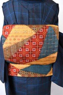 絣織の切り嵌め模様美しい正絹紬洒落袋帯