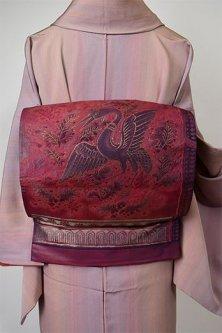 ガーネットルージュにオリエンタル鳥の装飾模様美しい洒落袋帯
