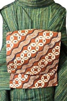 バティックのようなろうけつ染め波と七宝美しい木綿染名古屋帯