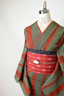 モスグリーンとオレンジブラウンの和更紗のようなストライプモダンなウール単着物