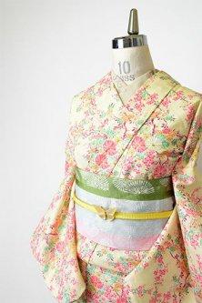 クリームイエローに桃源郷のような花枝染め模様美しいウール単着物