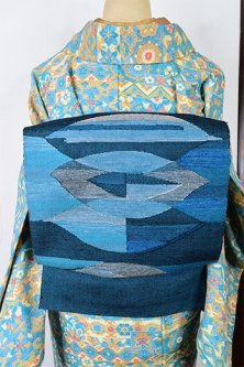 青色紬水面に映る木の葉のようなアートパターンモダンな開き名古屋帯