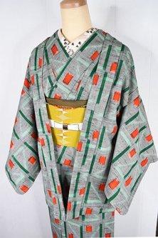 杢グレーにグリーンとオレンジルージュの北欧幾何学デザインモダンなウールアンサンブル