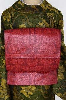 テラコッタルージュに迦陵頻伽のような装飾模様美しい洒落袋帯